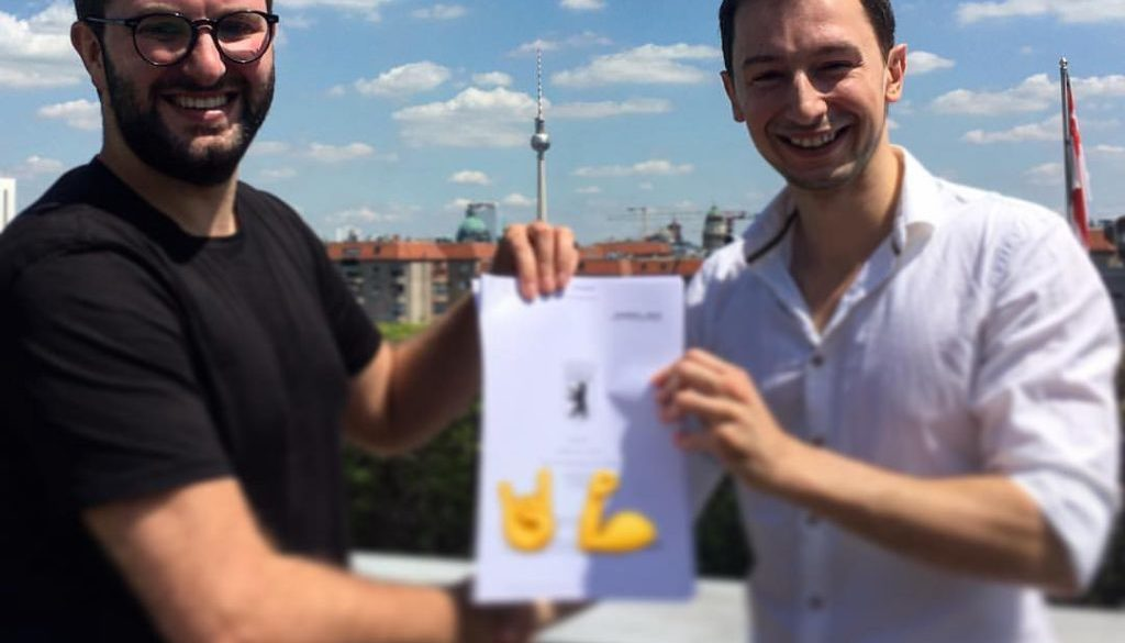 Till and Maciek with the signed acquisition agreement in Berlin, June 2017
