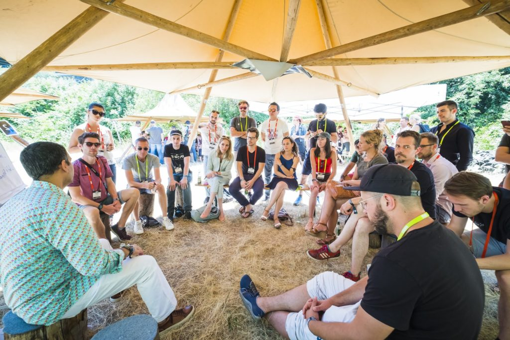 Group of People attending a campfire sessions at PIRATE Summit, Europe's craziest startup conference